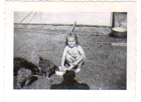 No 054 - Sylvia 2 years old - looks like Vista farm storage bldg and with Bunia's chickens.png