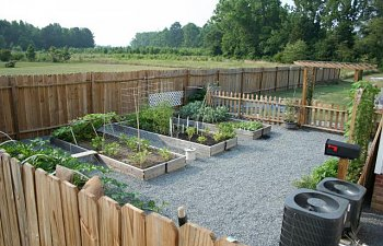46193_veggie_garden_looking_over_fence_from_front_porch.jpg