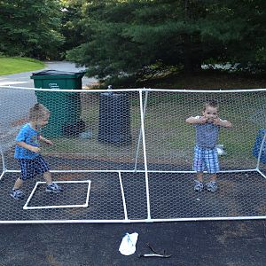 My twins goofing around inside while we were attaching the chicken wire! :)