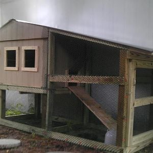 The home for our chickens constructed by my husband and 16 year-old son after the sticker shock of an $800 (WHAT?!!) coop for sale at a feed store.  It cost us only about $300 in material and is very heavy duty construction.