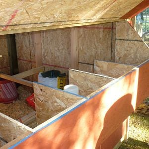 This is a view from the back of the coop.  The door can be raised for easy access to the nesting boxes to remove eggs without having to go inside the coop or the chicken run.