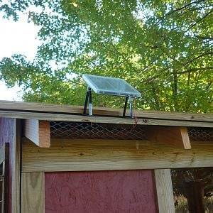 This is the solar panel for the automatic door.  Notice the vents under the roof.  There are vents under the nest boxes and around the sides too.  During the winter, the larger vents are covered with cut pieces of 2x6 boards with screws.  The screws can be backed out and the boards removed during the summer for air flow.