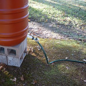 This is the water barrel.  Notice that it has a dual water spicket.  One has a hose attached that goes into the coop, the other will have a hose attached that goes into the run.  These feed water through PVC pipes in both the coop and the run providing water to the chickens via nipples.