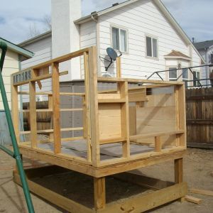 About half of the construction was done here and then the coop was moved up against the fence by sliding it on planks.