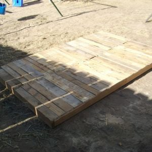 The floor made of reclaimed 2x4's and pallets