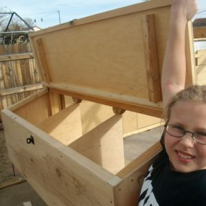 My daughter showing off the nest boxes.