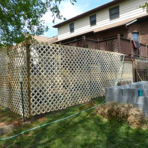 lattice on two sides - the side facing the pool will be left as hardware cloth so we can see the chickens when we're by the pool