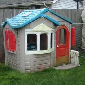 The playhouse that we found at our local dump thrift shop. Yep our dump has a thrift shop. We got the playhouse for $20.
