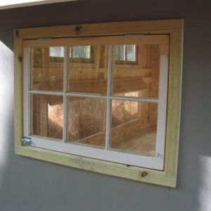 I used wood window sashes with hinges and slide bolts on all the windows.  Makes for easy access and good vents.   Chicken wire was installed on the inside of the windows above the nesting boxes so the sashes can stay open for ventilation.