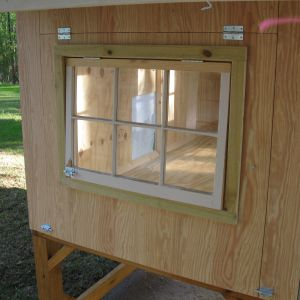 One end has a full width hatch door for easy cleaning and the window sash is also hinged.