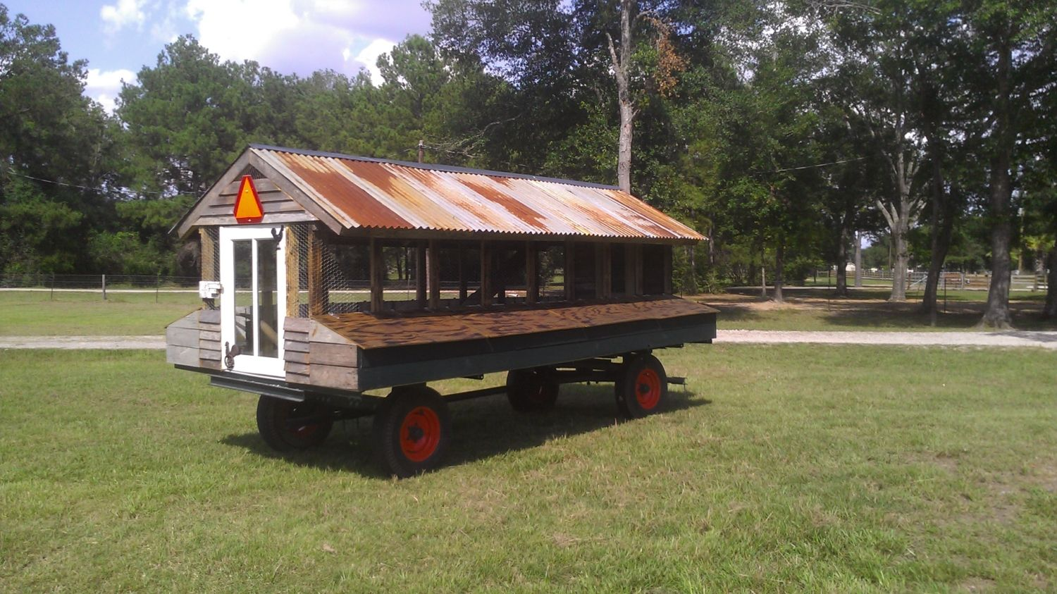 An old corn wagon backyard chickens for Mobile chicken coop plans