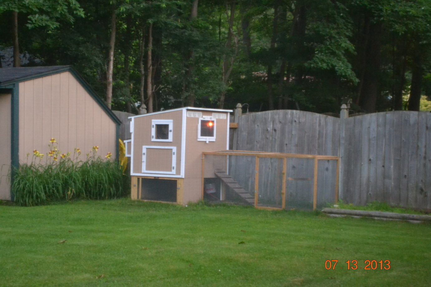 automatic chicken coop door for only 5 bucks with a radio antenna