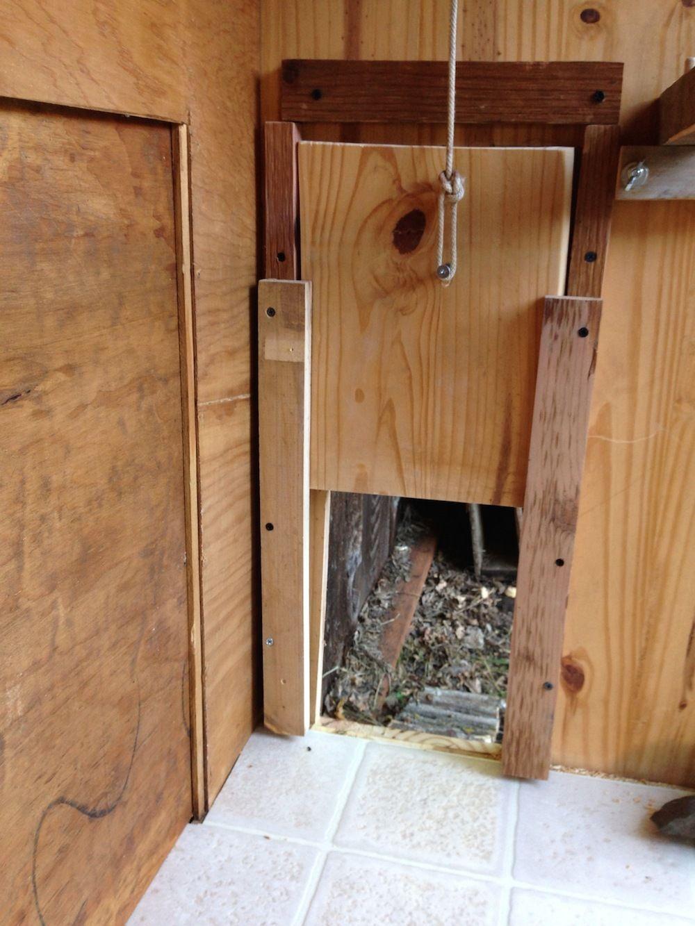 Very proud of my recycled coop and sliding door for D20 chicken coop motor door