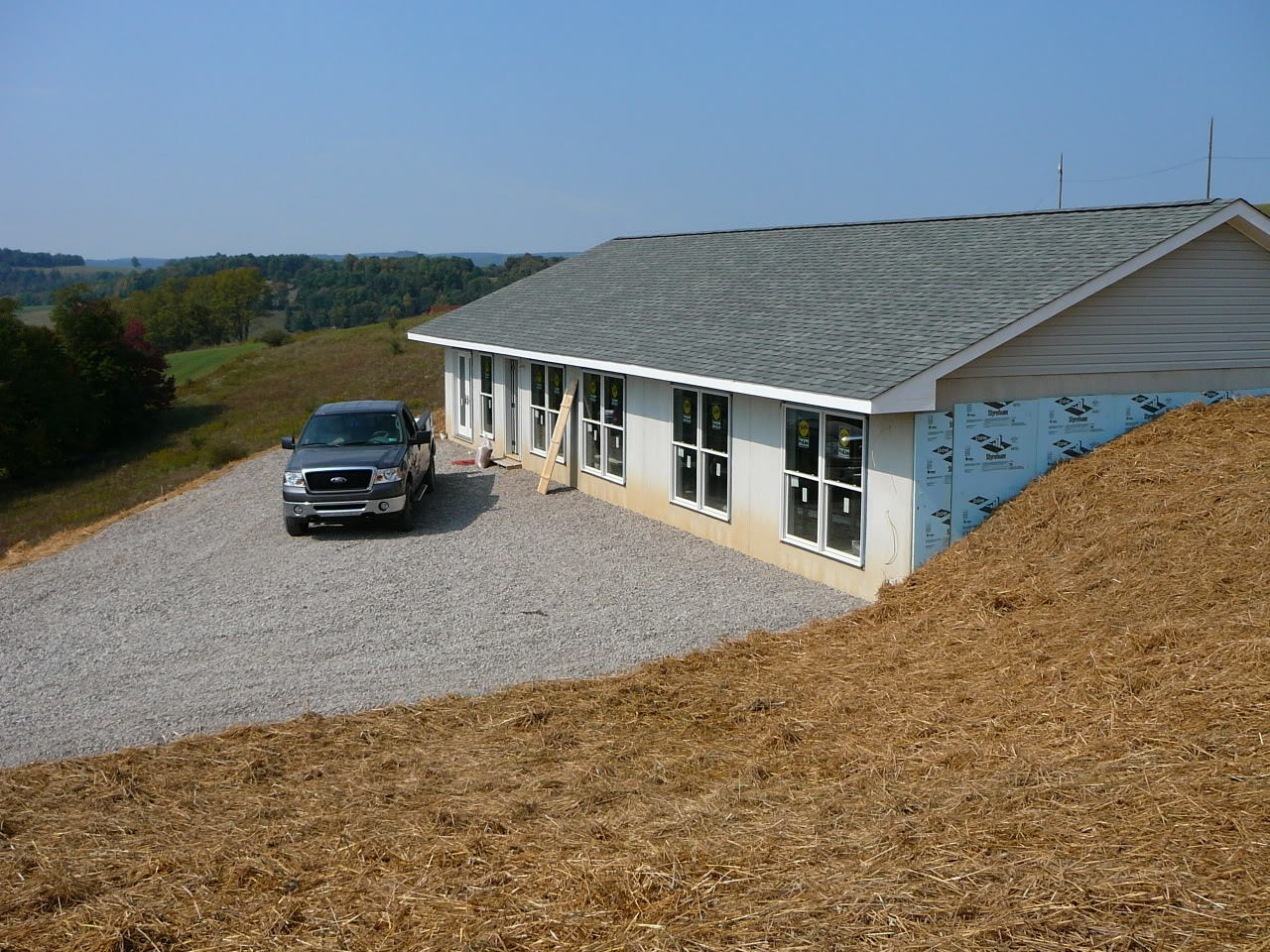 Most inexpensive style of home to build 1400sf with garage for Berm home