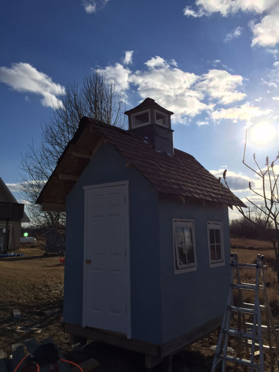 Finished shingling and adding the cupola.