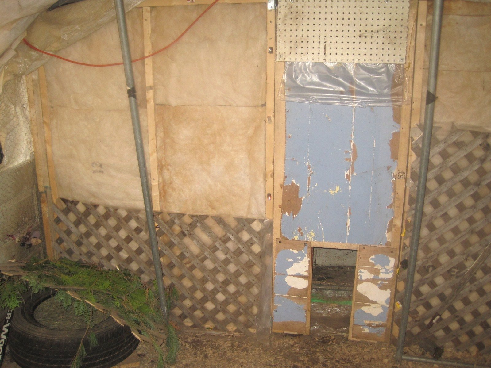 door closed. vents in top of door and with entrance for chickens