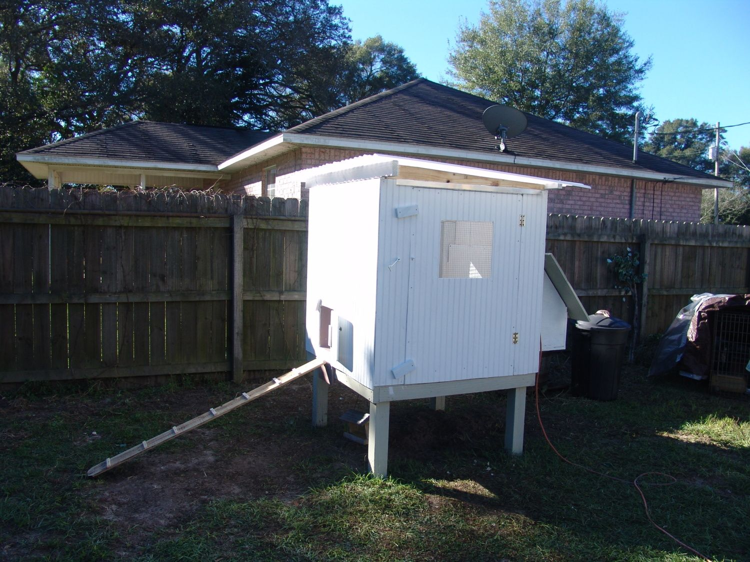 "My finished coop its 4 x 4 x4 with a nest box and 24"" off the ground."