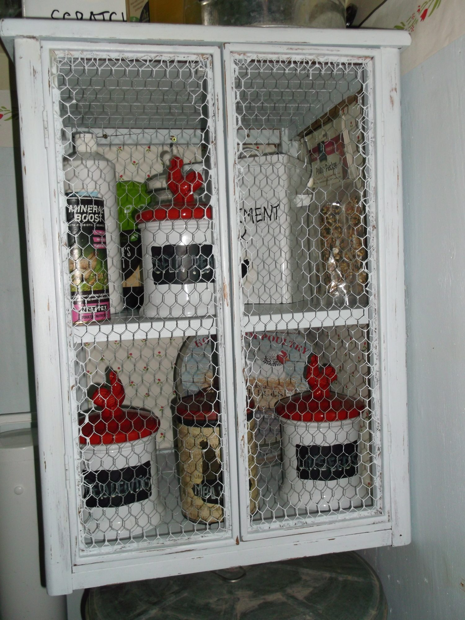 I ''upcycled'' another cupboard for storage in the coop