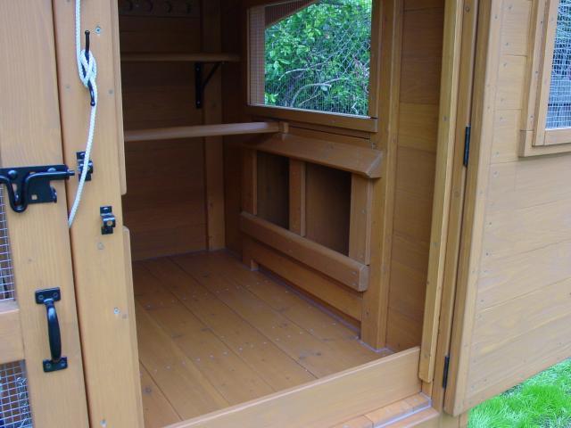 Wichita cabin coop backyard chickens for Chicken coop interior designs