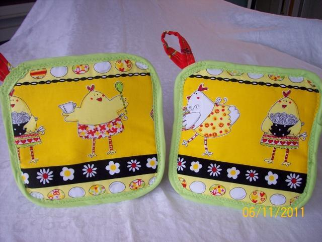 http://www.backyardchickens.com/forum/uploads/78250_chicken_chefs_potholder_640x480.jpg