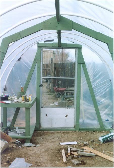 http://www.backyardchickens.com/forum/uploads/796_my_hoophouse_door.jpg