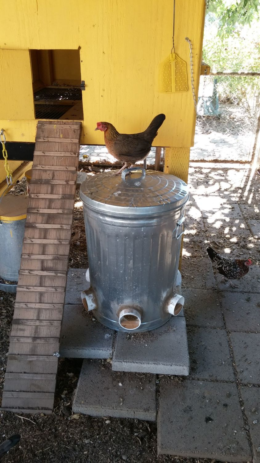 Lets see your diy no spill feeders and creative waterers for Diy chicken feeder light