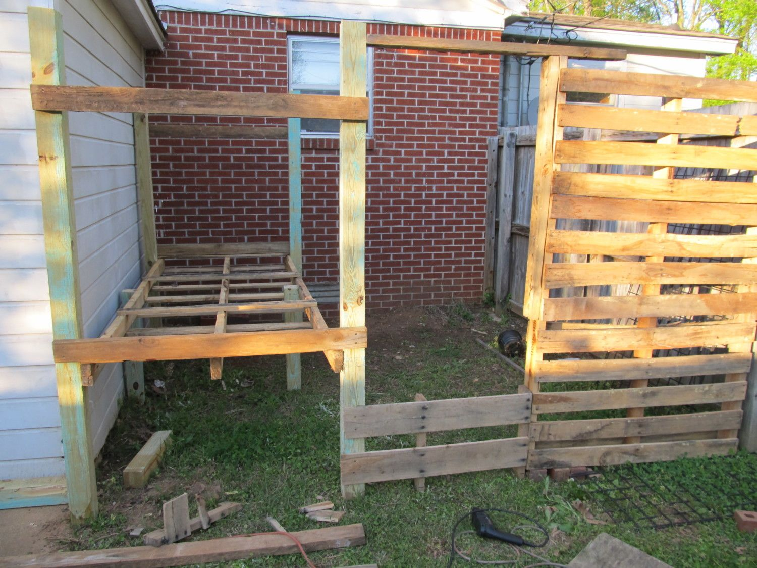 Our pallet reclaimed wood coop progress backyard chickens for Wood pallet privacy walls