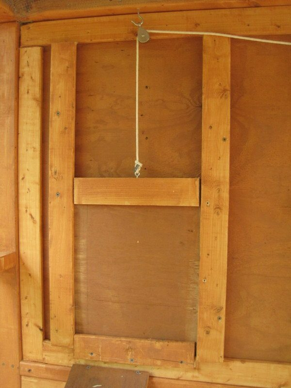 A cleat to tie off the pop-door rope. You can also see our barrel bolt with our lynch-pin lock. As a side note--does anyone know if a lynch pin is secure ... & UPDATE-FINISHED! New Coop from \